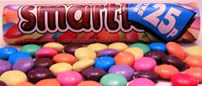 Smarties is a British candy which is a favorite among  Caribbean children (and adults).  English chocolate.