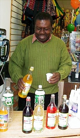 Oliver Samuels promoting Pure Bulk Syrup at Sam's Caribbean.  Jamaican syrup.  Jamaican food.  Caribbean food, jamaican drink.